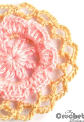 Round crochet motif with flower in the center preview