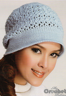 blue delicate crochet hat on a girl photo preview