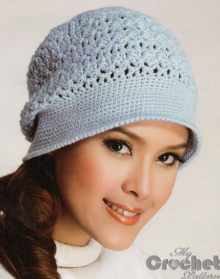 blue delicate crochet hat on a girl big photo