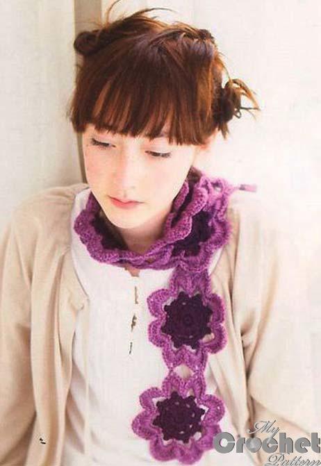 crochet scarf with purple flowers motif photo