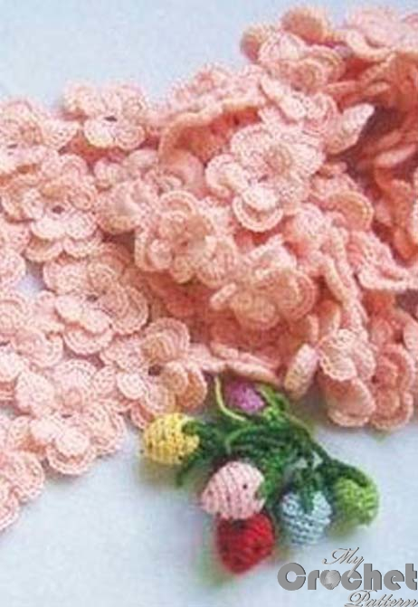 pink crochet scarf with small flowers photo