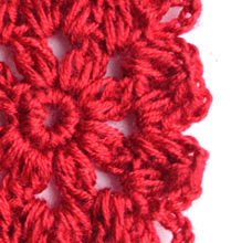 red crochet flower thic yarn