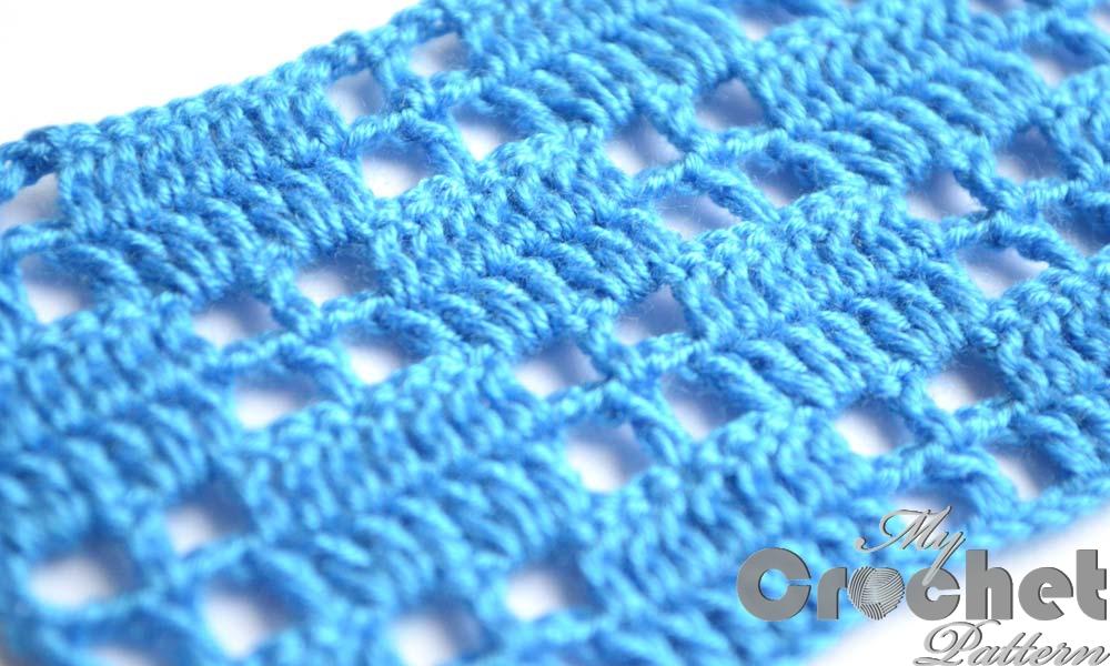 blue filet pattern little squares - close photo