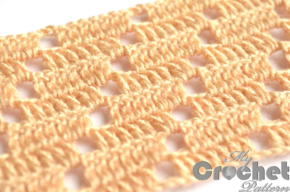 light brown filet pattern with squares - close photo